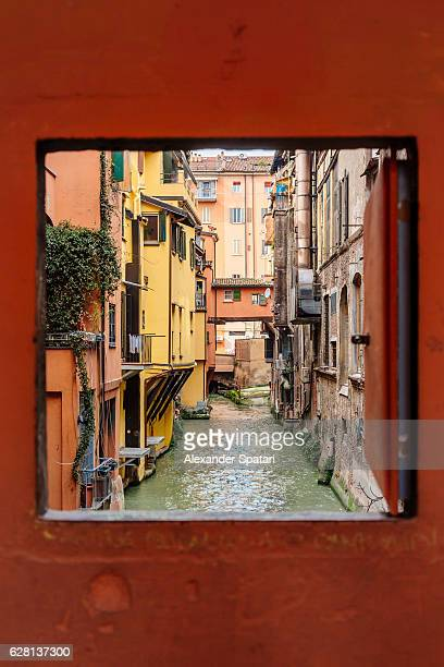 View to the canal through square window, Bologna, Emilia-Romagna, Italy