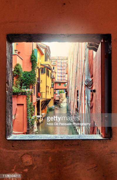 view to the canal through square window in bologna - nico de pasquale photography stock pictures, royalty-free photos & images