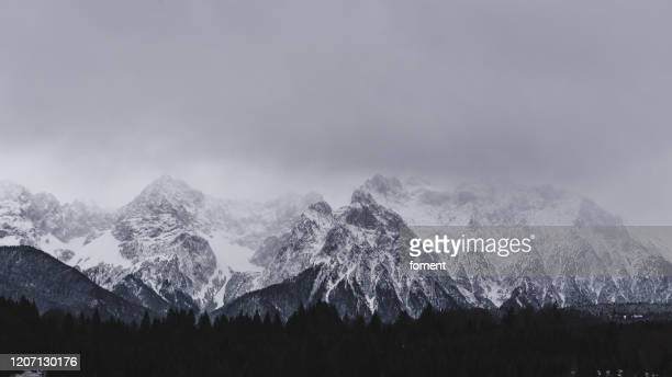 view to the karwendel mountains near mittenwald - bavaria, germany - mittenwald stock pictures, royalty-free photos & images