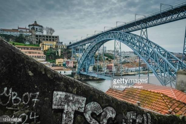view to the maria pia bridge in porto portugal - finn bjurvoll ストックフォトと画像