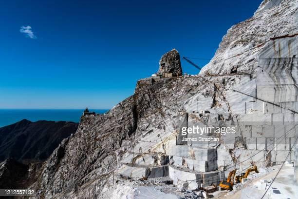 view to the sea from cervaiole marble quarry on mount altissimo, seravezza, owned by henraux, tuscany, italy (property release) - james strachan stock pictures, royalty-free photos & images