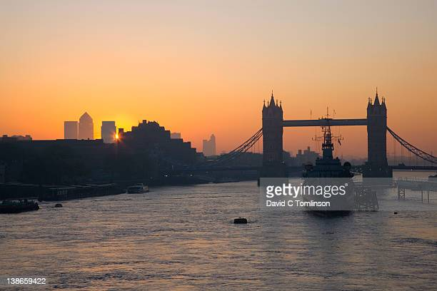 view to tower bridge at sunrise, london - royal navy stock pictures, royalty-free photos & images