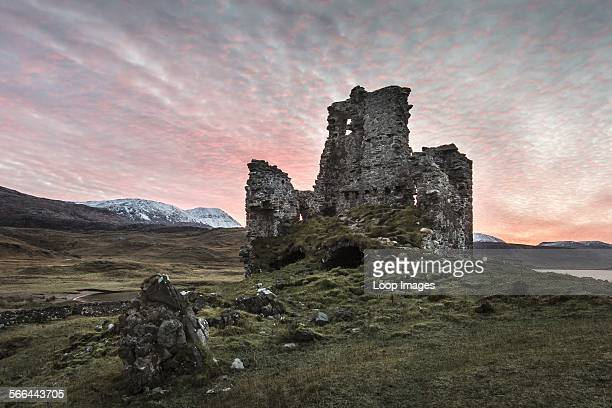 A view toward Ardvreck castle at sunset