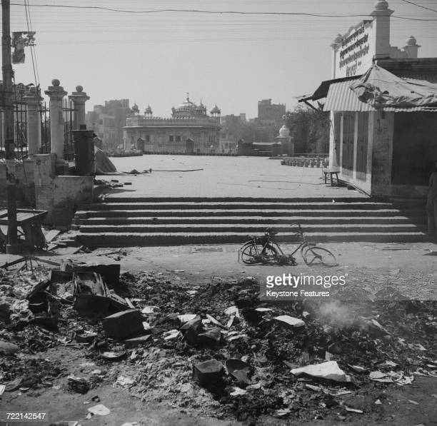A view towards the Golden Temple the holiest shrine of Sikhism after communal riots in Amritsar Punjab during the Partition of British India March...