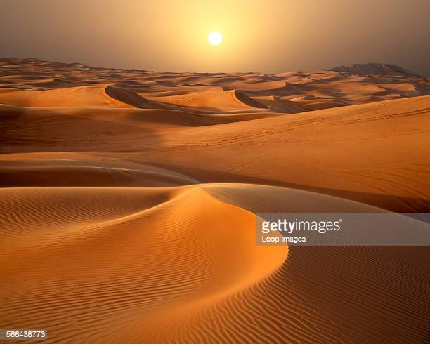 A view towards the sunset across the Dubai desert