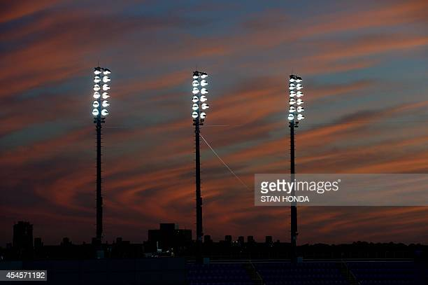 View towards the western horizon after sunset over the Arthur Ashe Stadium during the 2014 US Open tennis at the USTA Billie Jean King National...