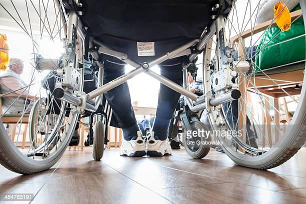 View under a wheelchair where a 90 year old resident is sitting in the common room of a nursing home pictured on October 16 2013 on the island of...