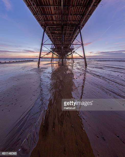 view under eastbourne pier, east sussex, england, uk - mattscutt stock pictures, royalty-free photos & images