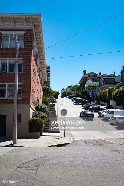 View up a steeply inclined section of Fillmore Street on which steps have been installed to make the ascent easier for pedestrians in the Cow Hollow...