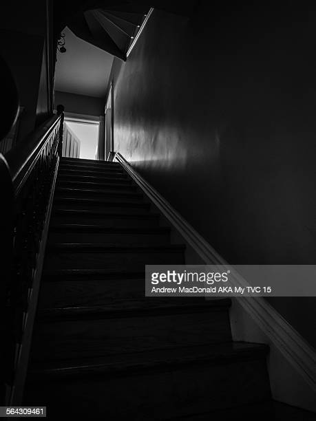 View up stairs in older style home.