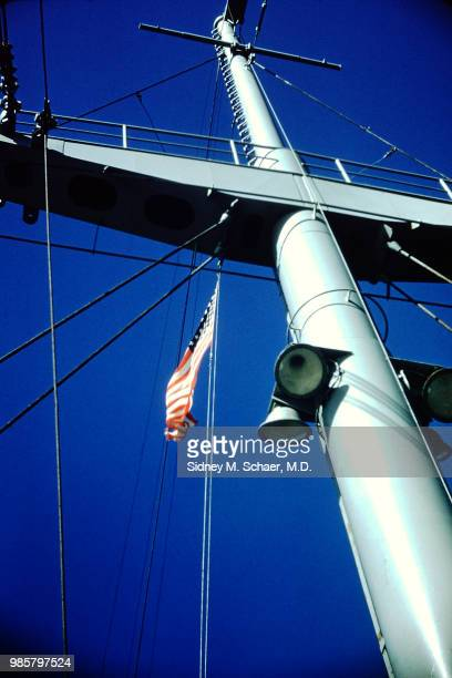 View up the mast of the USNS Marine Serpent transport ship which flies an American flag South Korea January 1952
