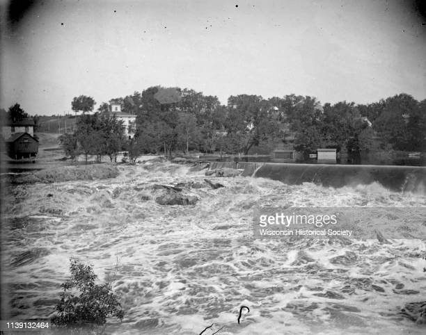 View upriver towards the dam with Black River Falls on the opposite shoreline Black River Falls Wisconsin 1909