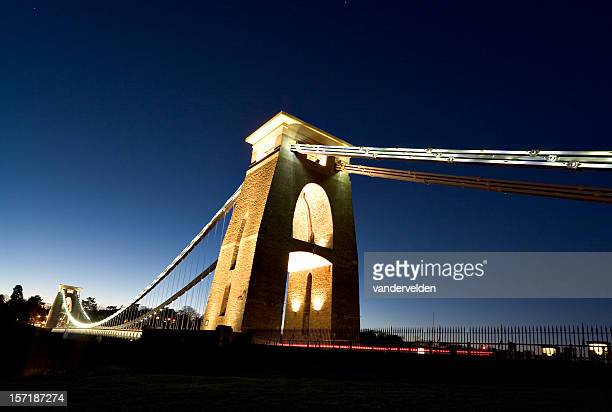 A view upwards of Clifton Suspension Bridge at night