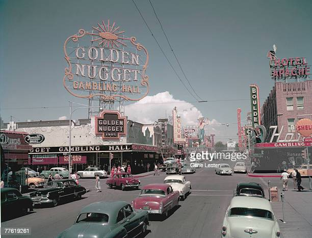 View west along Fremont Street near the intersection of South 2nd, Las Vegas, Nevada, July 1953. Visible are the Golden Nugget Gambling Hall, the...
