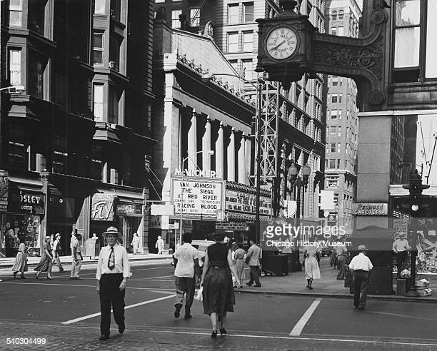 View west on Madison Street from the northeast corner of State Street Chicago Illinois June 17 1955 McVicker's Theater is visible