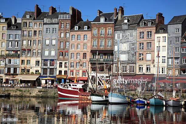 a view with boats in the water in honfleur, france - calvados stock pictures, royalty-free photos & images