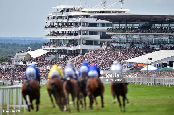 Viewed from the top of the course, runners and riders take the corner into the straight during the first race, on the second day of the Epsom Derby...