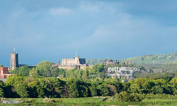 Viewed from the West, the Priory & Castle stand prominently on a hill. The hill was previously occupied by a Roman fort overlooking the river Lune.