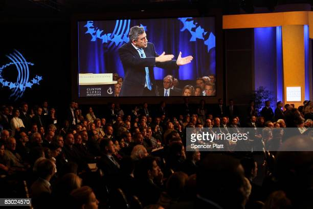 Viewed on a television screen surprise guest British Prime Minister Gordon Brown speaks during a session of the Clinton Global Initiative September...