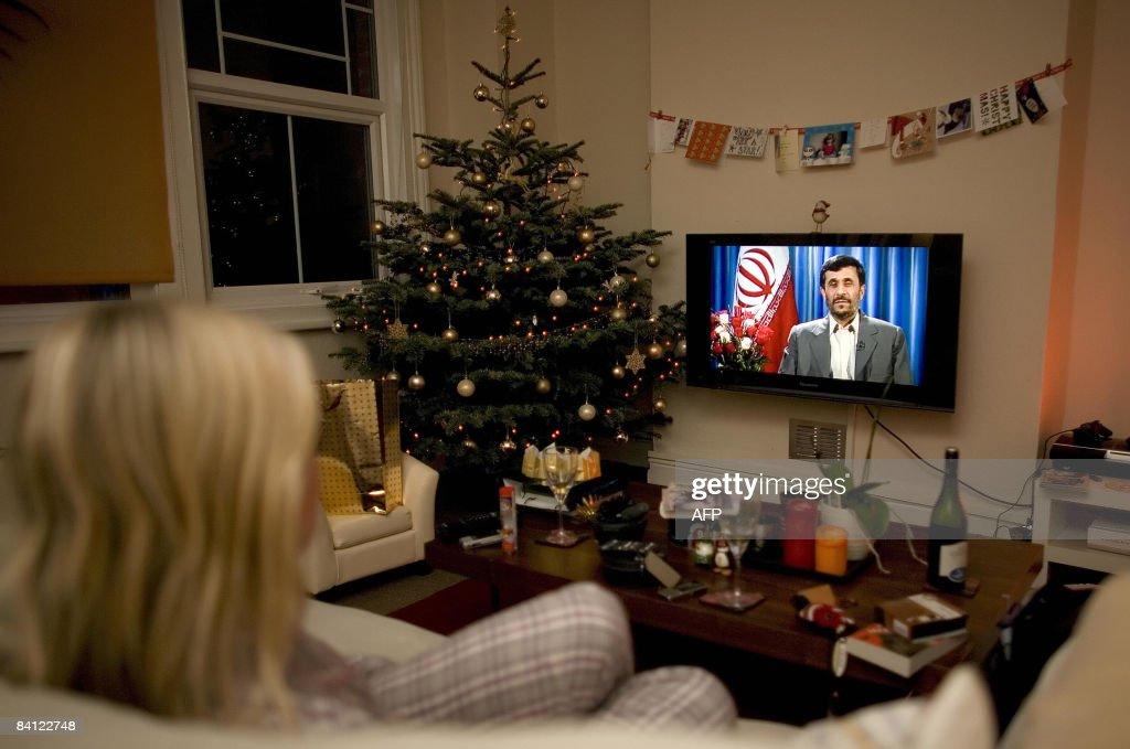 A viewer watches a transmission of Irani : News Photo
