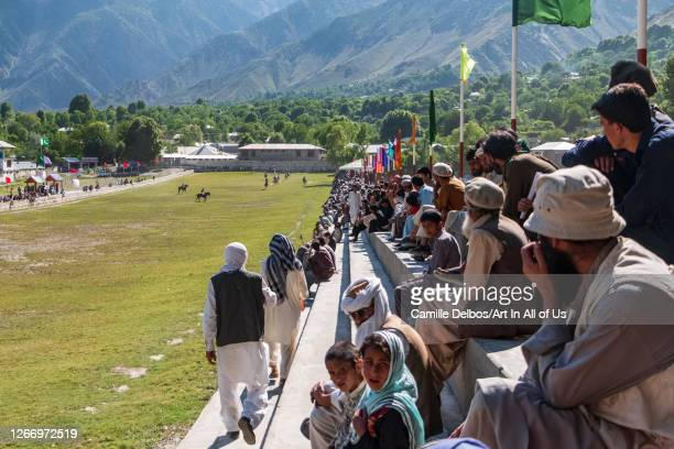Viewer watching polo been played on a polo ground on Mai 25 2016 in Chitral Khyber Pakhtunkhwa Pakistan