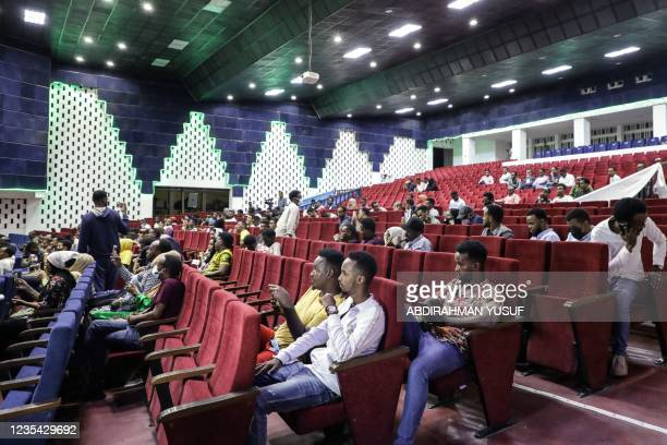 Viewers wait for the first screening of Somali films at The Somali National Theatre in Mogadishu, on September 22 which has been opened for the first...