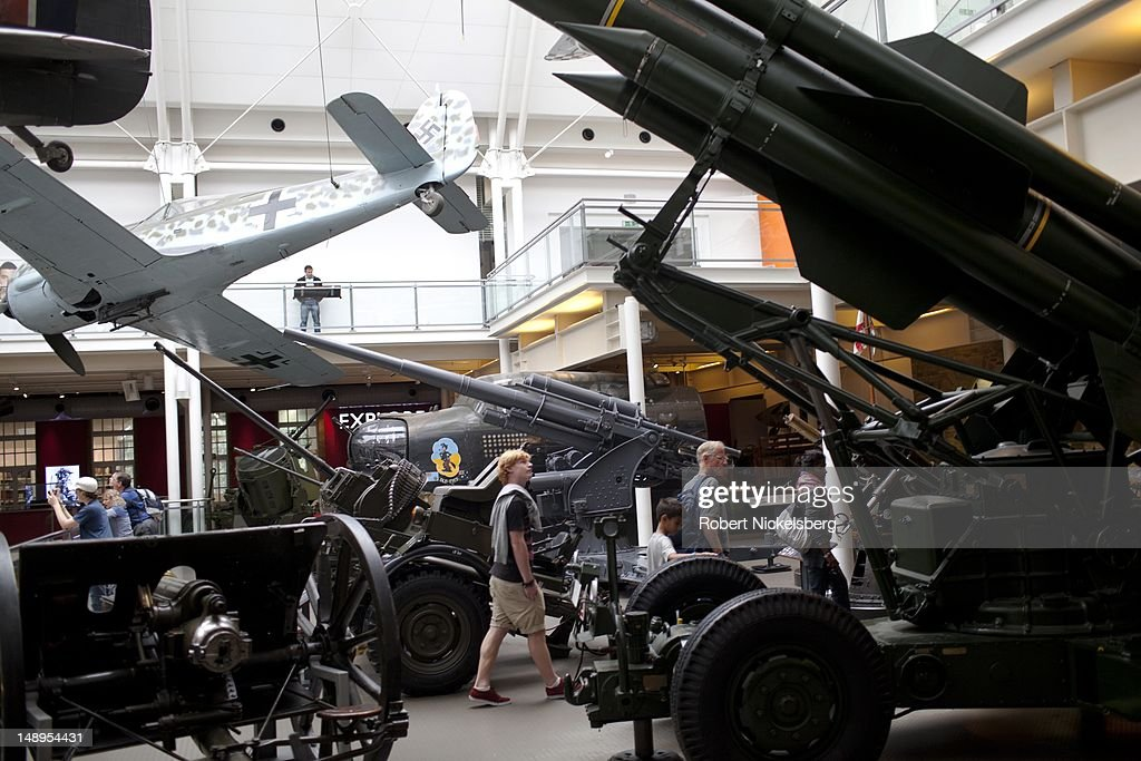 Viewers walk through a display of planes and weapons on exhibit at the Imperial War Museum July 3, 2012 in London, England. Founded in 1917, the museum houses armored vehicles, rockets, planes, weapons and exhibits exhibits from both world wars and recent conflicts.