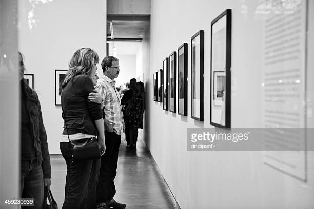viewing art work in a gallery - thursday stock pictures, royalty-free photos & images