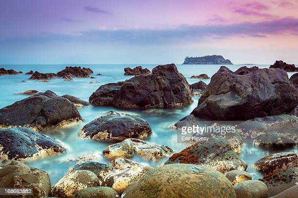 viewing beomseom island at sunset, jeju island - jeju stock photos and pictures