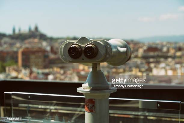 viewing glasses for a closeup view of barcelona skyline - binoculars stock pictures, royalty-free photos & images