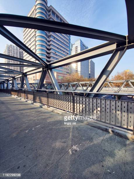 viewing high-rise buildings by the street from the open pedestrian overpass - アジア大会 ストックフォトと画像