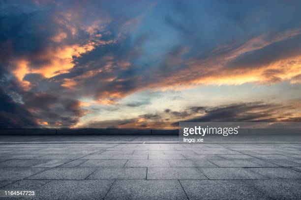 viewing the gorgeous sunset from the platform - avondschemering stockfoto's en -beelden