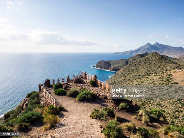 Viewing-point from the top of a mountain to the coast of the Mediterranean sea. Amethyst viewpoint, (Mirador de la Amatista), of the natural park of Cabo de Gata - Nijar, in Almeria,  Andalucia, Spain