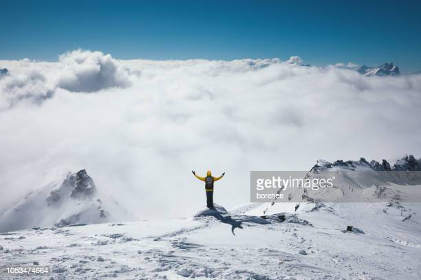 viewpoint above the fog - snowcapped mountain stock pictures, royalty-free photos & images