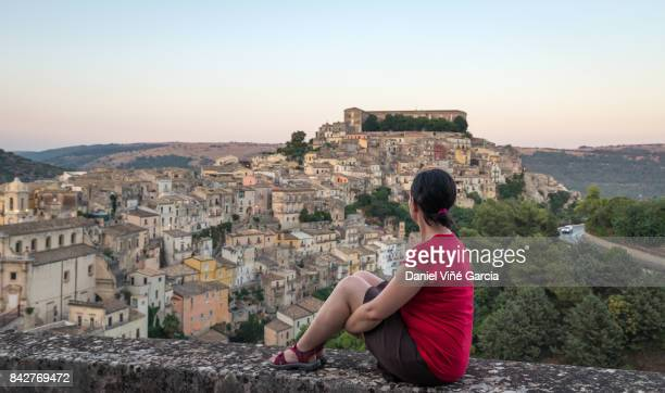 Viewpoint of Ragusa, Sicily with a woman.