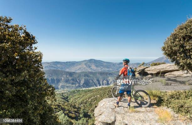 viewpoint to the sea, andalucian sierra nevada, spain. - cross country cycling stock pictures, royalty-free photos & images
