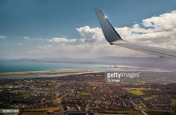 views from an aeroplane window - winged bull stock photos and pictures