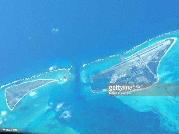 views from an aeroplane window - midway atoll stock pictures, royalty-free photos & images