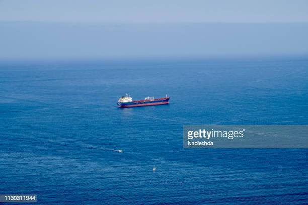 views of a cargo ship in the atlantic ocean - tipo de transporte stock pictures, royalty-free photos & images