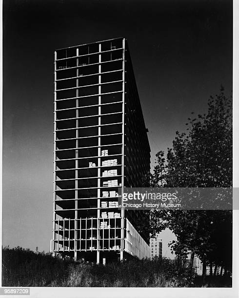 Views of constuction of a highrise building from the narrow end from the Lafayette Park housing complex Detroit MI ca1963 Designed by Mies van der...