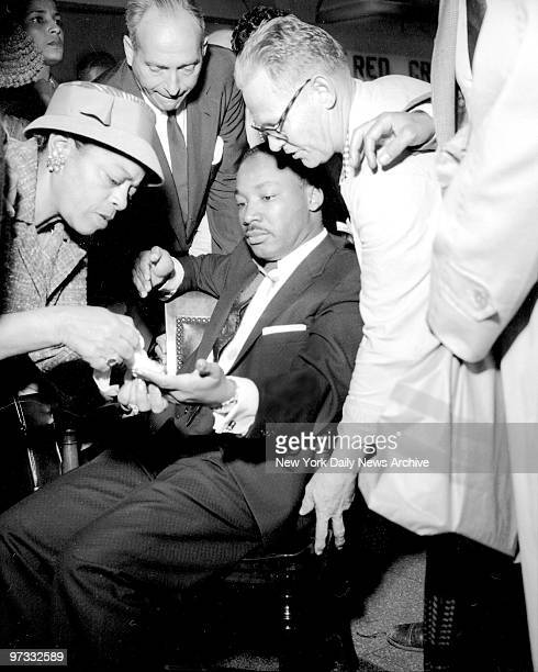 Views of Rev Martin Luther King as he was stabbed in chest with letter opener King was treated at W 123d Street Police Station as well as Harlem...