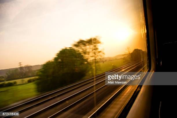 Views of the English countryside at dawn through a train window. UK