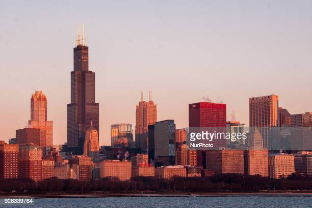 Views of the sun rising to illuminate the Chicago skyline from the Adler Planetarium on March 2 2018