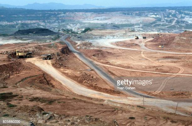 Views of the vast open cast lignite mine which supplies the Mae Moh Power Plant with 50,000 tons of lignite each day. Villagers living close to the...