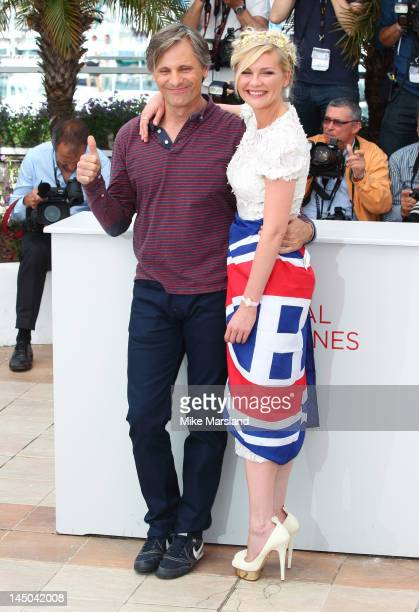 Viggo Mortensen and Kirsten Dunst attend the 'On The Road' Photocall during the 65th Annual Cannes Film Festival at Palais des Festivals on May 23...