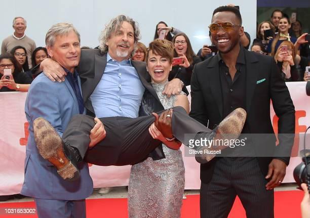 TORONTO ON SEPTEMBER 11 Viggo Mortensen Linda Cardellini and Mahershala Ali pick up Director Peter Farrelly on the red carpet of the world premeire...