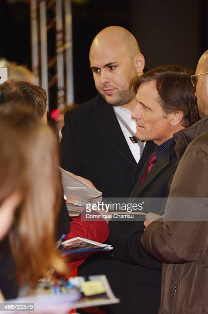 Viggo Mortensen signs autographs while arriving at 'The Two Faces of January' premiere during 64th Berlinale International Film Festival at Zoo...