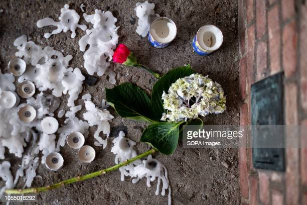 Vigil candles seen on the ground After the tragic shooting in Pittsburgh PA at the Tree of Life Community gathers from all different races and...