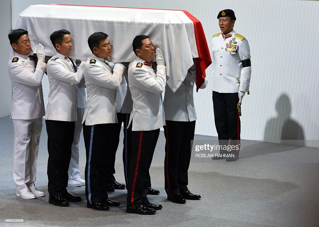 Vigil guards carry the casket of Singapore's late former