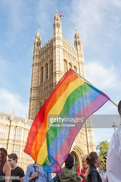 CONTENT] Vigil in support of equal marriage outside Parliament rainbow flag in front of Victoria Tower